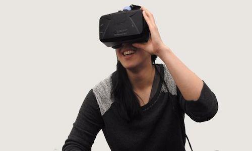 A woman wearing virtual reality goggles.